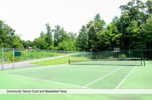 community tennis court and basketball hoop